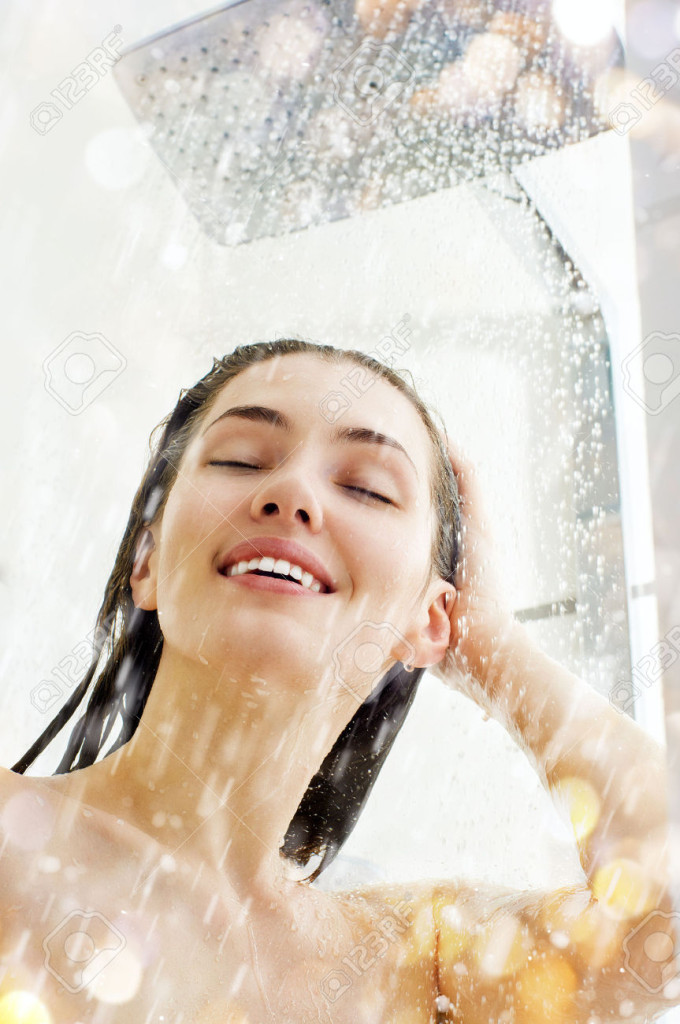 30995923-a-beautiful-girl-standing-at-the-shower-Stock-Photo-shower-woman-showering